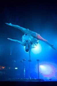 Contortionist Henna Kaikula balances over broken glass in circus show Cantina