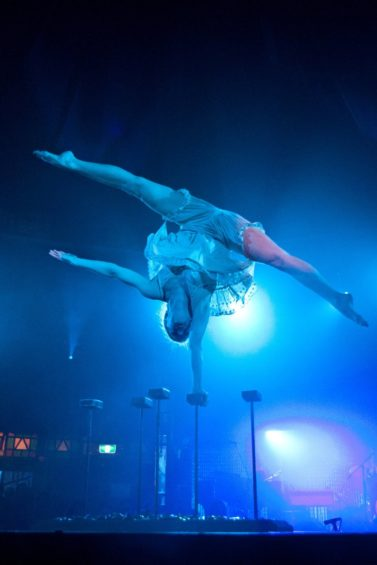 Contortionist Henna Kaikula balances over broken glass in circus show Cantina