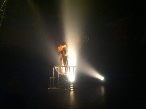 Cornelius Atknson and Kat Lilwall in Charlie Hain's atmospheric lighting of Midnight Circus