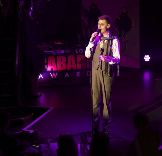 Dusty Limits accepting the Best Host/Compere Award at the London Cabaret Awards 2015. Image (c) Lisa Thomson